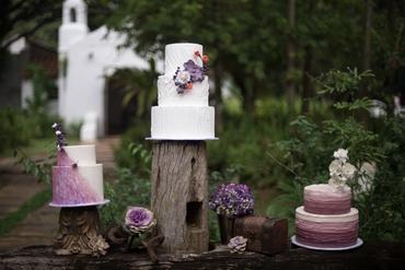 Outdoor purple wedding cupcakes