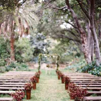 Rustic summer wedding ceremony decor