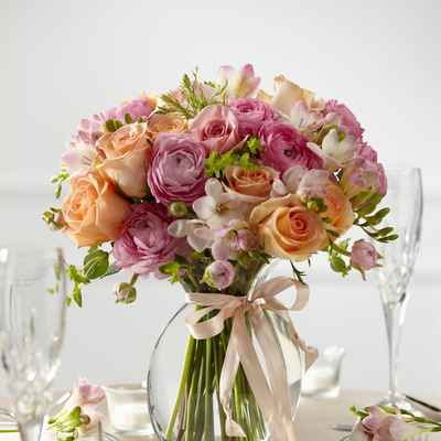 Outdoor orange wedding floral decor