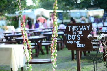 Outdoor brown wedding signs