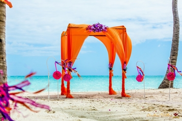 Beach orange wedding ceremony decor