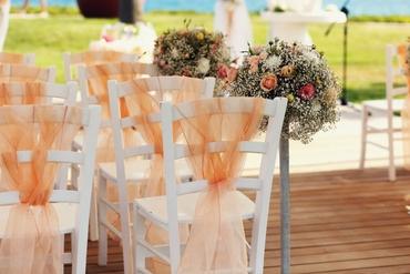 Outdoor orange wedding ceremony decor
