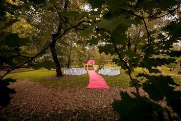Outdoor pink wedding ceremony decor