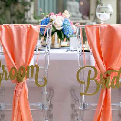 Orange outdoor wedding reception decor