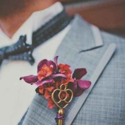 Purple wedding buttonhole
