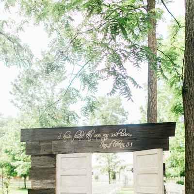 Rustic white wedding ceremony decor