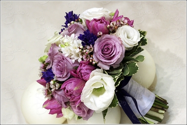 Spring purple rose wedding bouquet