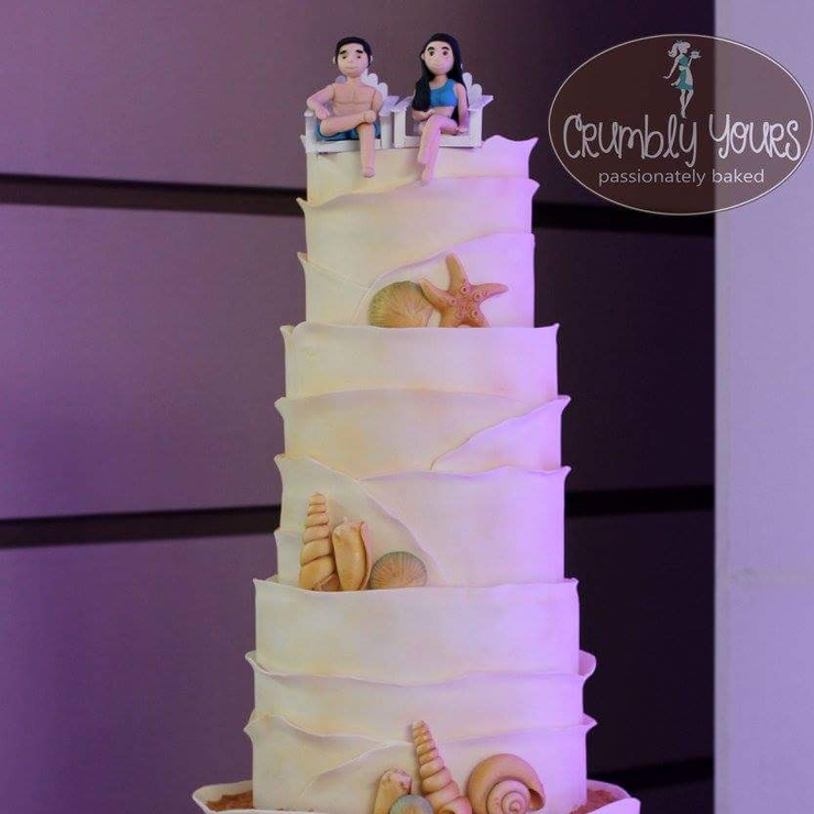 JC and Riz' Beach themed Wedding Cake with handmade fondant seashells and the Bride and Groom topper