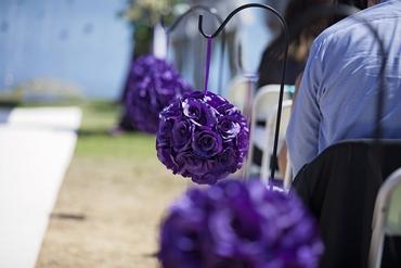 Outdoor purple wedding ceremony decor
