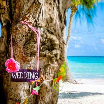 Beach pink wedding signs