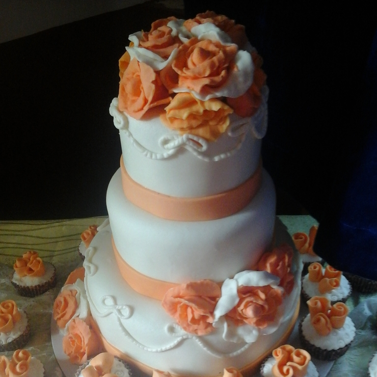 Peach and White Wedding Cake and cupcakes