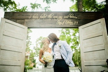 Rustic white wedding ceremony decor
