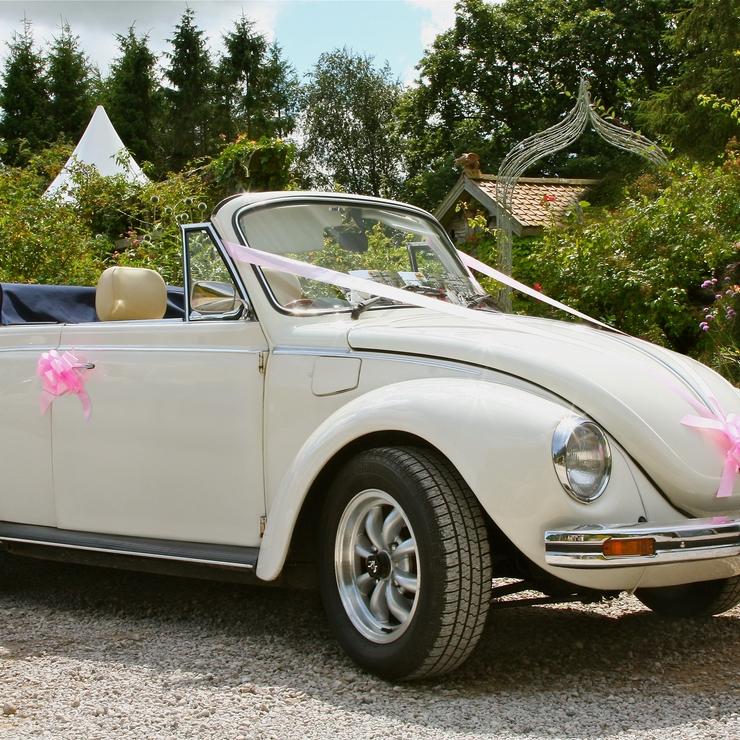 Summer Wedding? We offer a vintage VW Beetle Cabriolet in white.