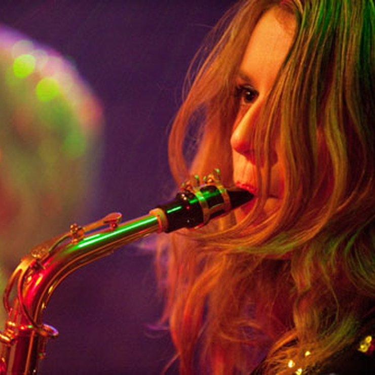 Tasha from Chemistry, playing sax