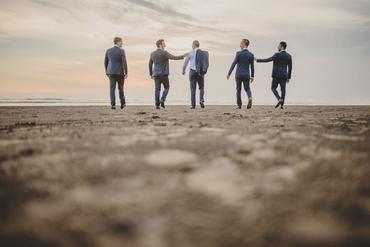 Beach black groom style