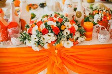 Orange wedding reception decor