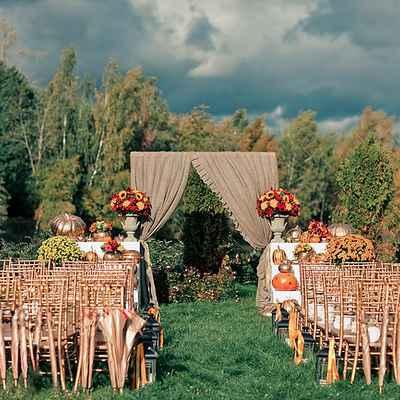 Outdoor autumn wedding ceremony decor