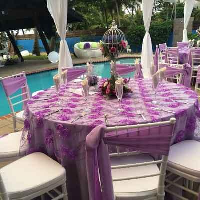 Outdoor purple wedding reception decor