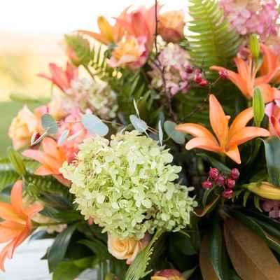 Outdoor orange wedding floral decor