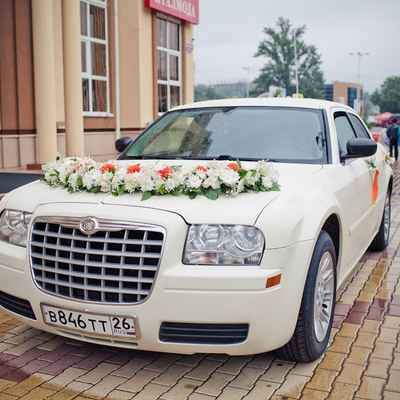 Orange wedding transport decor
