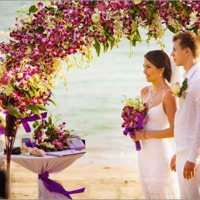 Beach purple wedding ceremony decor