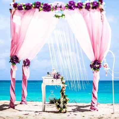 Beach purple wedding ceremony decor