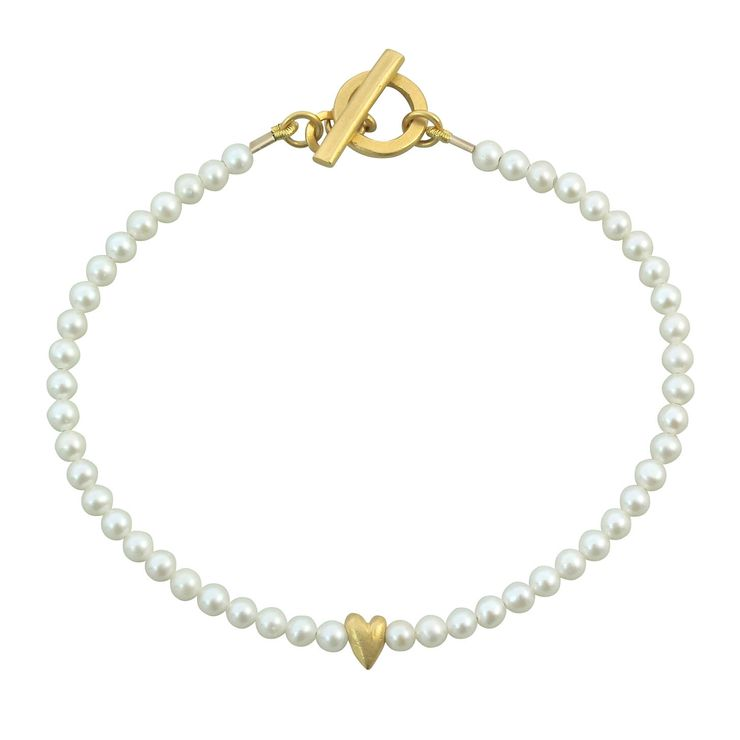 Pearl and tiny gold plated heart bracelet