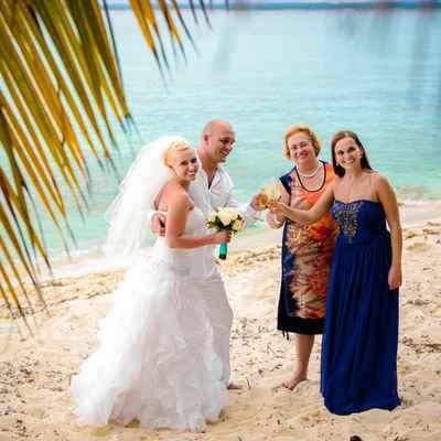 Beach white wedding guests