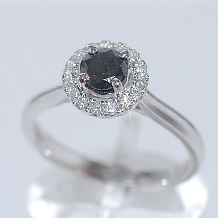Fancy coloured diamond halo rings.