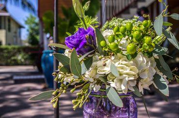 Outdoor green wedding floral decor