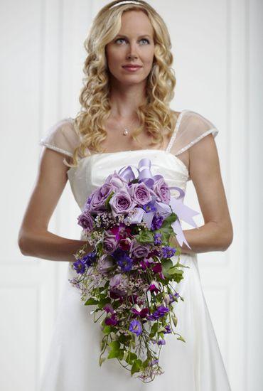 Purple rose wedding bouquet