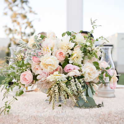 Outdoor ivory wedding floral decor