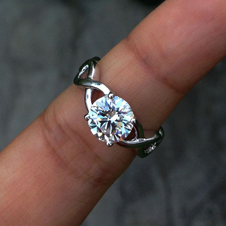 Infinity design side solitaire engagement ring