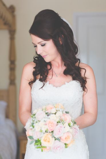 Overseas ivory rose wedding bouquet