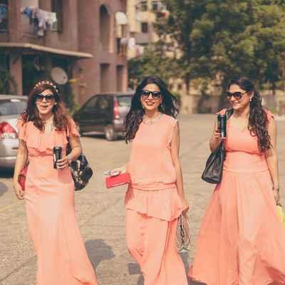 Orange outdoor bridesmaids