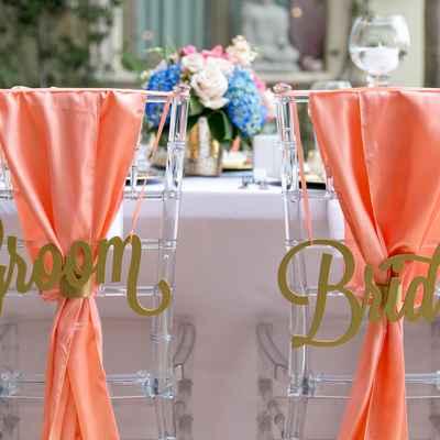 Orange outdoor wedding reception decor