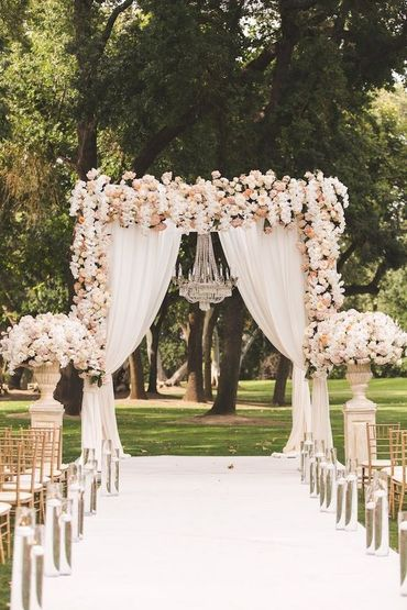 Ivory outdoor wedding ceremony decor
