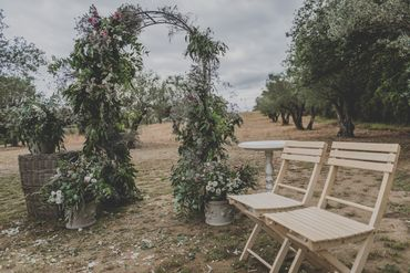 Green outdoor wedding ceremony decor