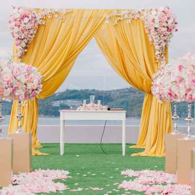 Orange outdoor wedding ceremony decor